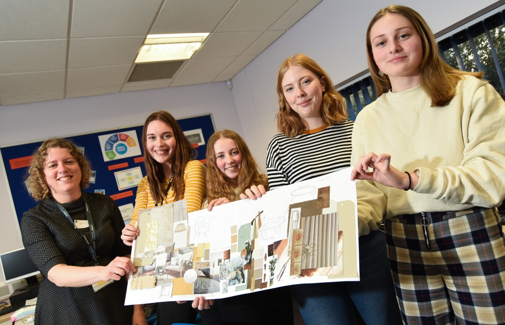 Broadland Growth and K3 Interior desingers working with 6th form students at Thorpe St Andrew High School to design rooms for a show home. Hazel Ellard Housing Development Manager for Broadland Growth with students.